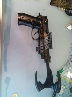 From plastic store-bought to cosplay prop http://www.goldenlasso.net/do-it-yourself-steampunk-weapon-2/