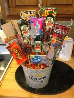 """Man Bouquet: I just recently made this for my boyfriend for his 25th birthday. It was super easy and fun to make. HE LOVED IT! I saw these bouquets all over the place with just alcohol or just candy but I decided to make it my own by adding all his favorite stuff. One of the things he said to me was """"you should put it on pintrest."""" So I am, you will need: wooden dowels, floral foam, a glue gun, tape, a bucket or vase, confetti or tissue paper, by sherri"""