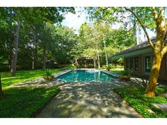 771 KUHLMAN. The backyard is complete with a heated pool, spa and water feature. Bernstein Realty, Houston Real Estate