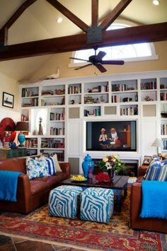 consider small upholstered cubes for sitting on while children homeschool at coffee table in library