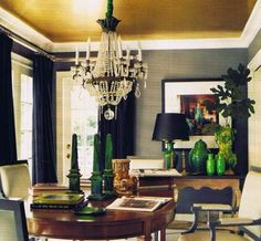 swanky dining room. love the dramatic curtains black, grey, brown room.