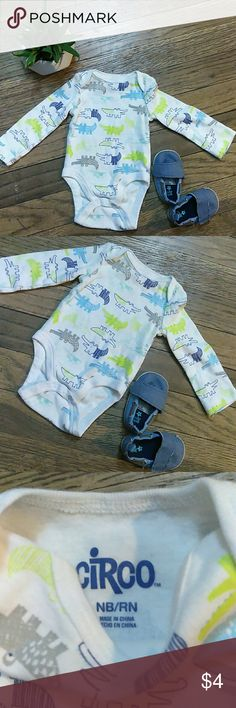 Newborn👣 Dinosaur long sleeve Onsie This is a Newborn White Dinosaur long sleeve Onsie. Dark Blue, Light Blue and Lime green🚼👣 baby Dino's. Made by Circo. ⚫100% Cotton soft material ⚫Made for Newborn Baby Boy ⚫ Excellent Used Condition ⚫ Like Brand New, used once 💙 Circo One Pieces Bodysuits