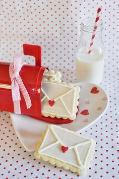 Adorable Valentine's Day cookie ideas: decorate sugar cookies as love mail envelopes and pair with a glass of milk