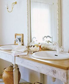 porcelain sinks mounted to a table - rustic and gorgeous!