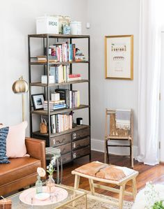 Nothing beats a cozy corner with an industrial bookcase and beautiful glam accents.