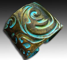 Old gold and patina polymer clay cuff by adrianaallenllc , via Etsy.