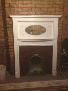 ANTIQUE 1930s WOODEN FIRE SURROUND WITH OVAL MIRROR. Ooh, lovely, streamlined but clean and modern.