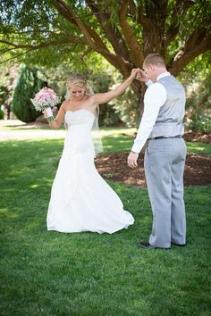 Bride giving her groom a full 360 twirl #mintandpeach #summerwedding #outdoorwedding #alllacedress #fitandflare