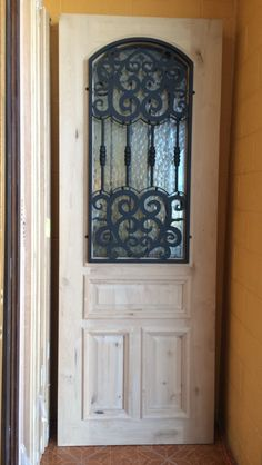 8'0 KNOTTY ALDER IRON GRILLE WOOD DOOR - FRONT DOOR - DOORS FOR SALE - WOOD DOORS - HOME IMPROVEMENT - AFFORDABLE PRICES - IRON GRILLE - TEXAS - HOUSTON -