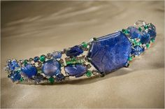 A Cartier Bandeau, circa Featuring carved gemstones, very popular with the Moghul rulers of India. Featuring a large lotus carved sapphire in the centre, with flanking open-work panels of carved emeralds, sapphires and diamonds. Art Deco Jewelry, Fine Jewelry, Jewelry Design, Art Nouveau, Antique Jewelry, Vintage Jewelry, Vintage Accessories, Faberge Eier, Sapphire Bracelet