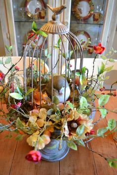 birdcage great idea..... just add candles around... it. this would also be great sitting on cake table with a garden wedding....