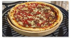 The Big Green Egg Deep Dish Pizza/Baking Stone enables you to bake a variety of recipes … from pizza, quiche and lasagna to pies, cinnamon rolls and desserts. Green Egg Pizza, Big Green Egg Table, Big Green Egg Grill, Green Eggs, Big Green Egg Accessories, Green Egg Recipes, Perfect Grill, Grilled Sausage, Baking Stone