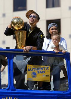 Warriors' Stephen Curry holds the championship trophy as he rides with his daughter Riley and wife Ayesha as the 2015 NBA champions Golden State Warriors  celebrate with a parade in downtown Oakland, Calif. on Fri. June 19, 2015. Photo: Michael Macor, The Chronicle