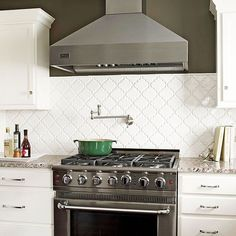 These backsplash tiles feature a Moroccan lantern shape with a sleek, unfettered... - http://whitetiles.info/these-backsplash-tiles-feature-a-moroccan-lantern-shape-with-a-sleek-unfettered.html
