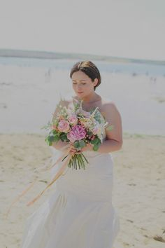 Bride wears a strapless fishtail gown by Kate Walker | Photography by http://jesspetrie.com/