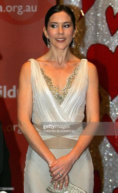 Denmark's Australian-born Crown Princess Mary wears an oyster-coloured silk evening gown to The Chocolate Lovers' Ball at Wrest Point Casino in her hometown of Hobart, 11 March 2005. The 13-day official visit is Mary's first to her home country as Scandinavian royalty with Crown Prince Frederik. AFP PHOTO/POOL/Torsten BLACKWOOD