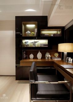 Modern Home Office. Magnificent Wall design, lighting showcasing art