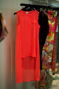 A simple sheer shirt with a dropped hem in a bright neon. So versatile, yet complies with the current trends.