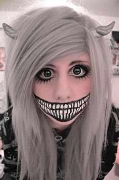 Halloween costume makeup, similar to the Cheshire Cat