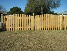 "Scallop cut picket fence designed by Mossy Oak Fence Company. An excellent choice for those needing a beautiful wood fence without feeling ""closed in."""