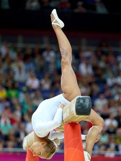 Vasiliki Millousi of Greece competes on the beam in the Artistic Gymnastics Women's Team qualification on Day 2 of the London 2012 Olympic Games at North Greenwich Arena.