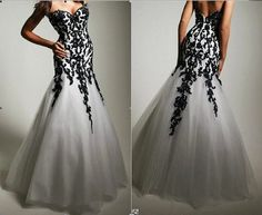 @Tiffany Grace  I know it isn't all black but you would look gorgeous in this dress 2013 black  white mermaid wedding dresses handmade by VEILDRESS, $156.00