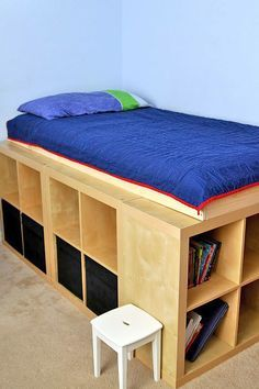 From 'IkeaHackers' this DIY storage bed is based on the Expedit shelves, and is pure genius for anyone with small bedrooms.