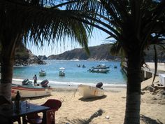 Puerto Angel, Oaxaca, Mexico.  This is my favorite beach in the world.  It's hard to get to, but that's probably what helps to keep it so special.  Here you have crystal-clear waters, a protected bay (no big waves or sharks), lots of fishing boats (it's a working town) palapa restaurants on the shore with all the ceviche and cold beer you could want, and really nice people.  The perfect place to swim, relax, eat, go snorkeling, and just dig your toes in the sand while you enjoythe best that ...