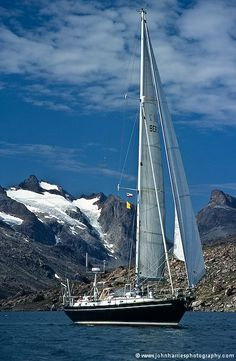 Aluminum expedition sailboat Morgan's Cloud underway in Prins Christians Sund, Greenland.