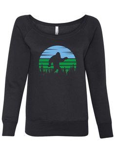 Looking for a fun vintage sweatshirt to keep you warm? This Sasquatch or Bigfoot Womens graphic sweatshirt is super soft and cozy. Perfect for adventures in the woods. Get yours today. #revivalink #sasquatch #bigfoot #bigfootsweatshirt #sweatersforwomen #printedsweaters #printedsweatshirts #longsleeveshirts #womenstyles #womenfashion