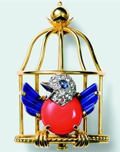 Created by Toussaint and Pierre Lemarchand, the design of the singing bird in an open cage, a symbolic concept of France's newly restored freedom from the German occupation and the end of the war. Coral, diamonds, lapis lazuli, platinum and yellow gold.