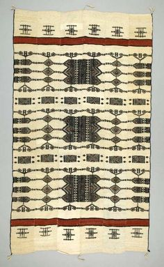 Africa | Blanket ~ Khasa ~ from the Fulani people from Mali | Wool; Strip woven; plain woven; supplementary weft; hand-sewn | ca. 1980. | The Fulani people of West Africa are known for their woven blankets, or khasa, made of wool from the sheep they herd. The Fulani use these blankets to protect themselves from the cold and mosquitoes during the cold and humid seasons, respectively.