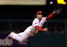Cardinals shortstop Pete Kozma makes a diving catch of a ball hit by Pirates' Neil Walker Wednesday. (Jeff Roberson/AP)