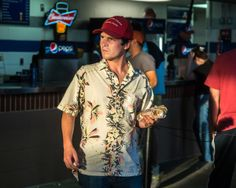 """A look back at the photography of the Bull City Summer series, now on view at Raleigh's North Carolina Museum of Art. Photography: Frank Hunter, """"Man with a hotdog."""" #baseball"""