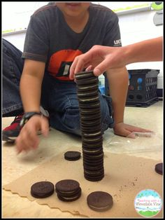 Students stack Oreos to make a tower. They collect data on how tall their towers can get and then use that data to practice data management, like mean, median, mode, and range. We also made it into a line graph!