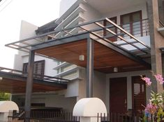 http://okerumahminimalis.com/images/model-kanopi-kayu-minimalis.jpg