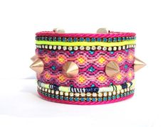 AW2012 Friendship bracelet cuff Spikes series - hot pink and neon yellow statement spikes cuff with genuine Swarovski chrystal rhinestones. €110.00, via Etsy.
