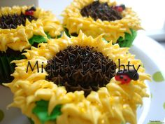 sunflower lady bug cupcakes by MightyMorgan (chocolate flavored w/ a different flavor icing...)
