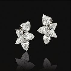 PAIR OF DIAMOND EARRINGS, HARRY WINSTON. Each designed as a cluster, set with five pear-shaped diamonds, mounted in platinum.