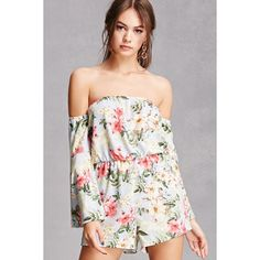 92e464fb8d8 A woven romper featuring an allover floral print