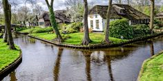 Outside of Amsterdam, he tiny town of Giethoorn in northern Holland may look like it was built for a film based on a children's fairytale, this enchanted neighborhood that's built upon a network of narrow canals is actually completely real.