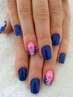 Sophisticated blue nail art design. Midnight blue polish is used as the base color with a cute corset design.