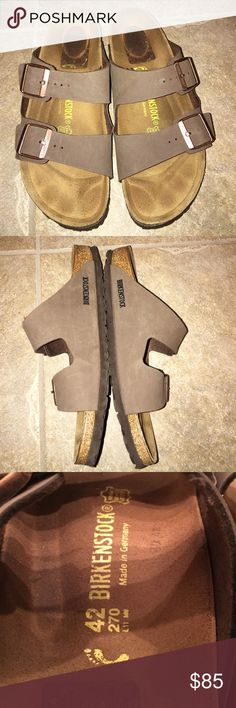 Birkenstock arizona womens sandals sz 42 /11 These were wron once like new heels have marks from price sticker but no glue residue just marks womens sz 42 wich is a womens 11 they are not the soft footbed NO TRADES Birkenstock Shoes Sandals