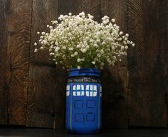 Hey, I found this really awesome Etsy listing at https://www.etsy.com/listing/216582620/tardis-painted-mason-jar-doctor-who-vase