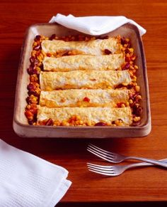 Budget Cheesy Baked Tortillas recipe  UBER EASY...Id put refriedbeans abd cheese…