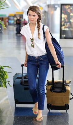 Airplane travel style -- breezy shirt tucked into jeans (but no belt), neat braid, sunnies