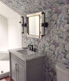 The perfect floral for a bathroom with calming muted tones with our Marianne wallpaper. Caroline Brackett Studio of Design.