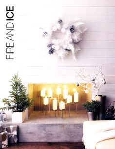 Clean silver and white Christmas decorations, Fireplace Christmas candles #camillestyles