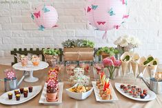 This wonderful garden themed table was designed by Kreavie for a Sweet 16 birthday party. You could recycle the concept for a baby shower or a toddler birthday. The mix of sweet and savory food provides an occasion to be more creative with the food presentation.