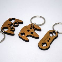 Video game console controller keychains, laser cut from wood http://lacersedge.lacernet.com/pages/fanplay